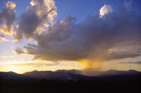 Sunset while raining over Mt  Mansfield, Stowe, Vermont photo