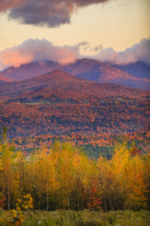 Fall foliage landscape with Mt  Mansfield in the background, Stowe, Vermont, USA photo