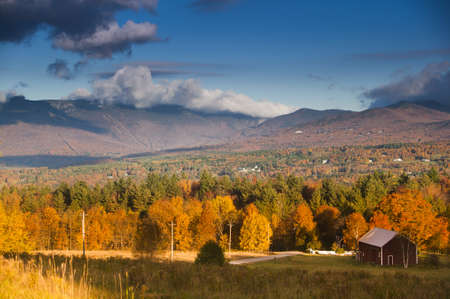 Fall foliage landscape with Mt  Mansfield in the background, Stowe, Vermont, USA