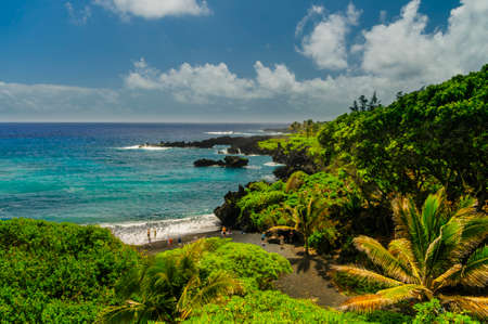 Waves breaking on the rocks on a sunny day during a spectacular ocean view on the Road to Hana, Maui, Hawaii, USA