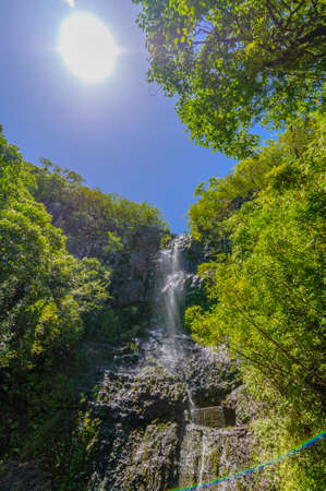 Waterfall in a lush tropical valley on The Road to Hana, Maui, Hawaii, USA photo