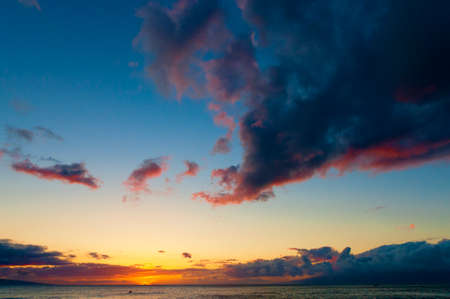 Colorful sunset on the Pacific Ocean at Kaanapali on the tropical island of Maui, Hawaii, USA photo