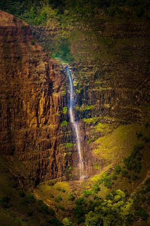 waimea canyon state park: Overlooking Waimea Falls in Waimea Canyon State Park on the island of Kauai, Hawaii, USA, nicknamed the Grand Canyon of the Pacific