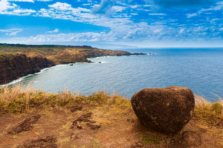 Boulder on a edge of cliff overlooking the Pacific Ocean, Maui, Hawaii, USA Stock Photo