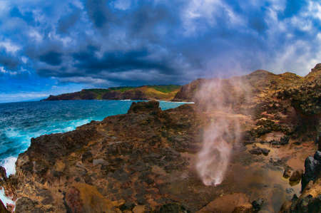 blow hole: Water blown out from blow hole caused from a Pacific Ocean wave on the Maui coastline, Hawaii, USA