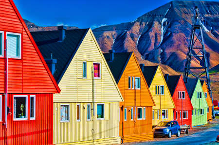 Digitally enhanced row of very colorful homes in Longyearbyen, Svalsbard, Norway. photo