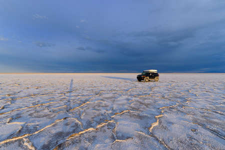 Black 4x4 truck covered in salt at the Bonneville Salt Flats, Utah Stock Photo - 23340342