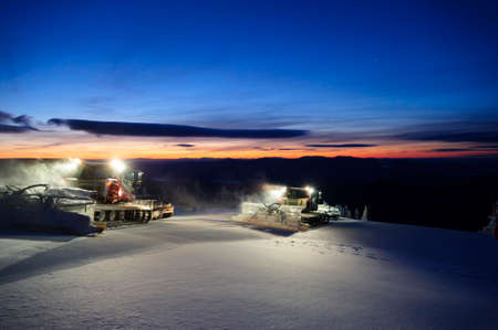 snowcat: Snowcat grooming trails in the early morning in Stowe, Vermont, USA