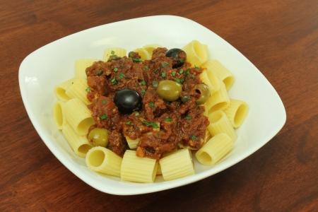 puttanesca: Vegan Pasta Puttanesca Stock Photo