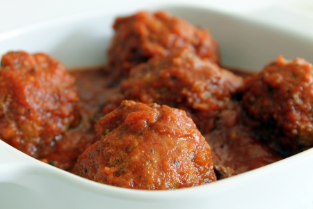 cooked pepper ball: Meatballs in a White Casserole Dish Closeup Stock Photo