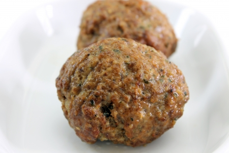 Two Meatballs on a plate without sauce