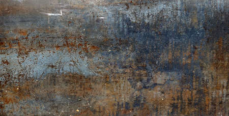 Rusty metal surface with red, black and orange tones