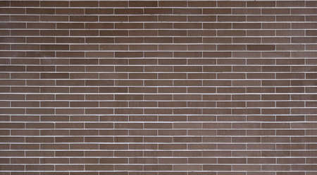 big brick wall with dark brown or garnet color - regular and well aligned bricks background wallpaper
