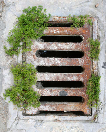 old sewer with rusty railings and grass around - urban steampunk background complement