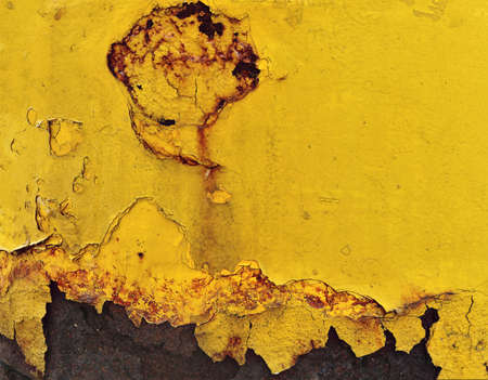 rusty deep yellow metal with very damaged and broken industrial surface - worn steampunk peeings painting with dirty metallic background