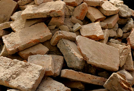 rubble with broken brick pieces from a destroyed wall after a demolition or an earthquake Banque d'images