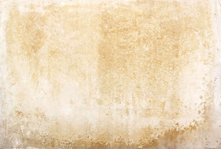 old blank stone wall or dirty paper texture background in white or beige color with moisture