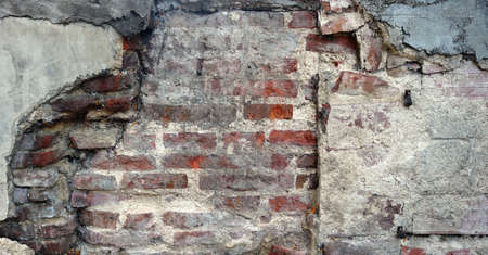 old damaged wall with red bricks and concrete background texture