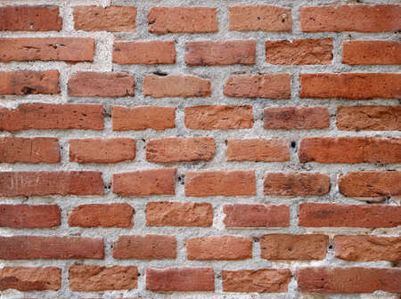 brick wall background with old red, brown and orange bricks texture Reklamní fotografie