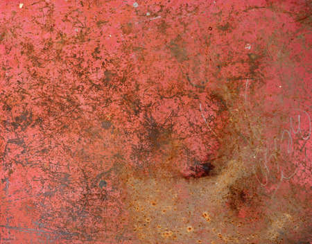 rusty metal surface with red, pink and orange tones - worn background with scratches
