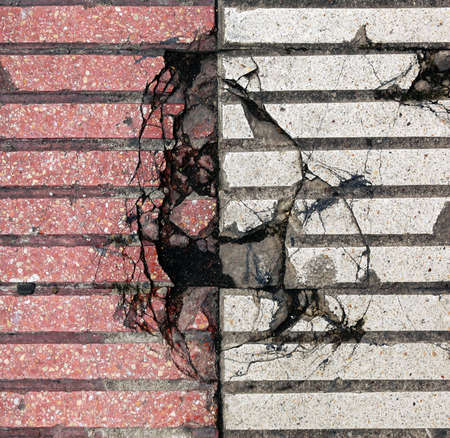 broken and cracked white and red tiles with a hole in the floor - background texture Reklamní fotografie
