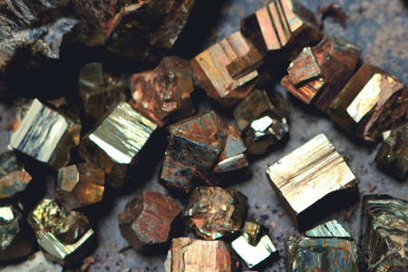 geometric and irregular pyrite ore cubic pieces with colorful metallic texture - macro treasure
