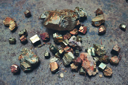 pyrite ore pieces with metallic texture and colorful cube shapes - top view treasure