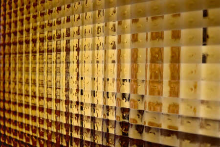 abstract golden background with small transparent squares of glass from a vintage door - geometric wallpaper Reklamní fotografie
