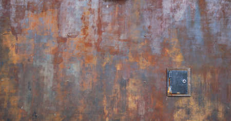 rusty metal surface with small door - worn industrial steampunk background with scratches and bad painted