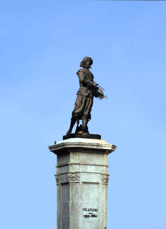 Statue of the Spanish painter Velazquez in Seville, isolated over the blue sky