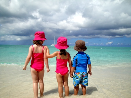 bathing man: adorable children on beach facing the tropical waters