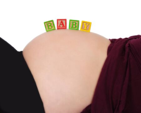 beautiful bare pregnant belly with alphabet blocks spelling Stock Photo - 9458261