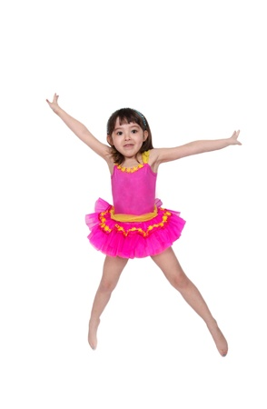sweet girl jumping in air wearing a pink tu-tu. isolated