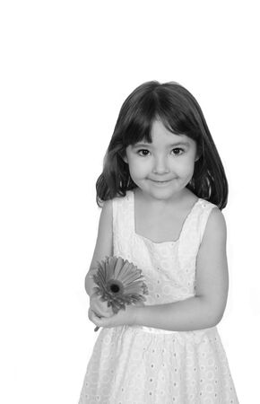 stamin: sweet little girl posing with daisy in black and white. isolated