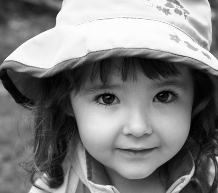season photos: adorable little girl closeup in black and white