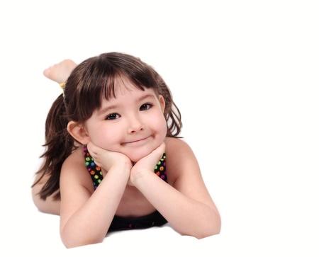사랑스러운 작은 소녀 턱 손에 함께 수영복 포즈. 화이트 절연 스톡 콘텐츠