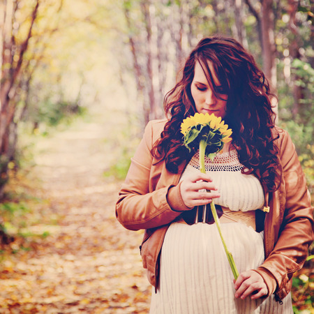 stunning pregnant woman on forest path