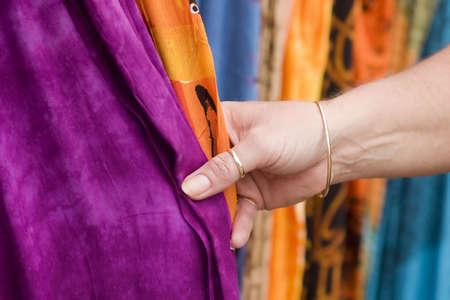 woman touching fabric