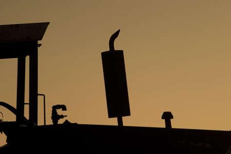 tractor at sunrise silhouette exhaust Reklamní fotografie - 340758