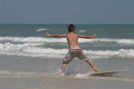 young boy on surf board Reklamní fotografie
