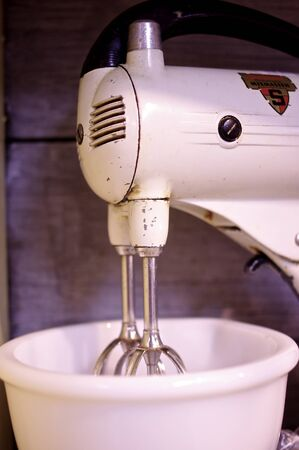 beater: Vintage Sunbeam Standing Electric Kitchen Mixer on display at an antique shop.