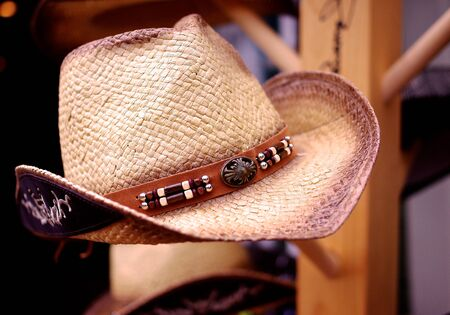 antiqued: A Straw Cowboy Hat on Display Stock Photo