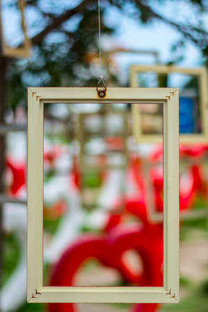 A picture frame hang on tree. photo