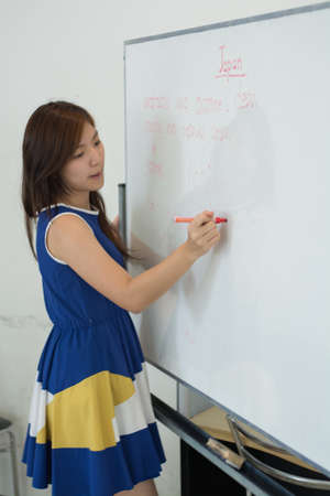 business attire teacher: The girl is teaching how to speak Japan language by English language.