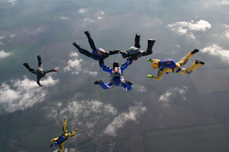 parachutists: The group of parachutists in air