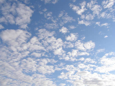 cloudscape  with white clouds and blue sky photo