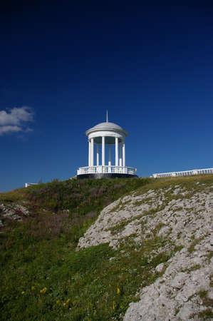 rotunda: White marble medieval rotunda overlooking sweeping mountains. Stock Photo