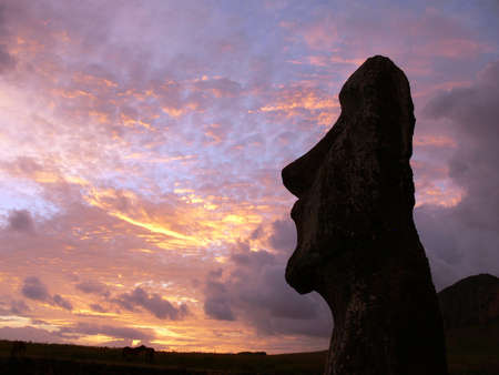 moai: A stone statue on Easter island at sunset