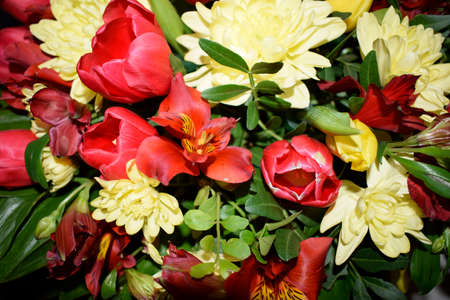 Bright bouquet of different flowers. Mixture of different colors of artificial carnations, for decoration