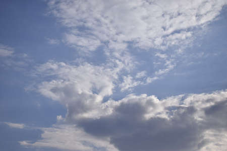 Blue sky and white clouds. Beautiful movement clouds in the sky. The formation of rain clouds.
